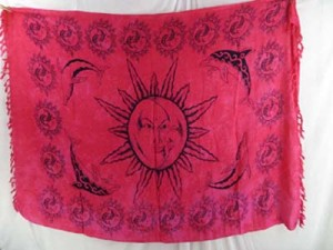 red sarong primitive celestial sun moon face and dolphin mother nature and animals