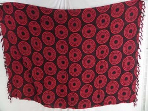 red coin circle on black background lava-lava mundu pareau casual clothing