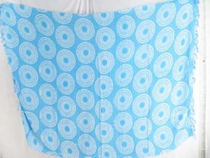 coin circle on turquoise blue background beach tahitian coverup