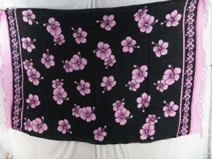 fashionable wholesale clothing sarong pink hibiscus flowers black background