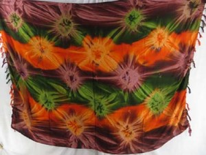 hand tie-dyed starburst heppy apparel sarong in green orange brown