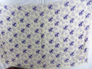 sarong sarung batik purple elephant biege background