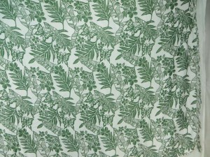 green leaf flower on white sarong