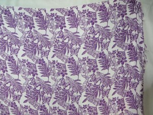 purple leaf flower on white sarong