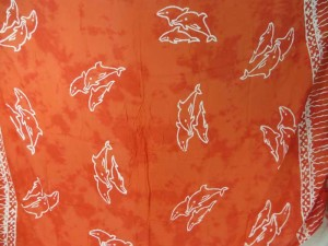 orange red monocolor sarong with gecko, flower, turtel, fish, sun, dolphin, seashell, palm trees etc tropical designs assorted designs randomly picked by our warehouse staffs