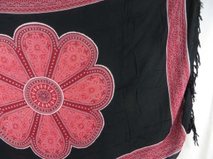 giant red daisy on black sarong