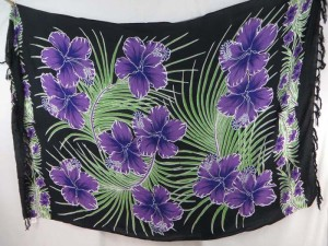 purple hibiscus flower green leaf sarong on black background