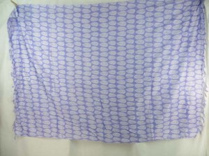 white leaf on light purple sarong
