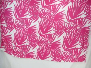 pink plam tree leaves on white sarong