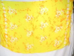 yellow monocolor sarong with gecko, flower, turtel, fish, sun, dolphin, seashell, palm trees etc tropical designs
