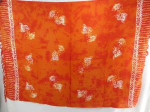 orange monocolor sarong with gecko, flower, turtel, fish, sun, dolphin, seashell, palm trees etc tropical designs