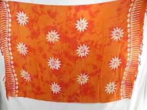 orange monocolor sarong with gecko, flower, turtel, fish, sun, dolphin, seashell, palm trees etc tropical designs