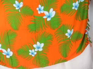 orange sarong blue plumier flower green leaf