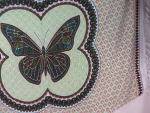 thousand dots butterfly sarong red green on white