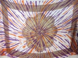 giant daisy mandala on centre tie dye sarong with purple orange rays