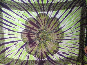 giant daisy mandala on centre tie dye sarong with purple green rays