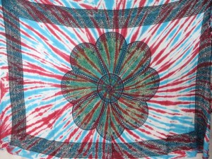 giant daisy mandala on centre tie dye sarong with red blue rays