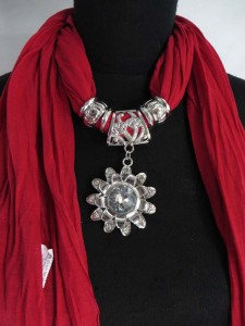 sunflower pendant charm scarf necklace, scarves with jewelry attached. The scarf is made of polyester jersey material but feels like soft cotton