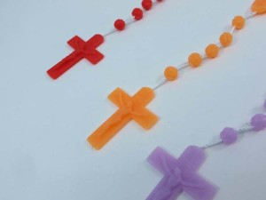plastic beads and cross rosary pendant on string