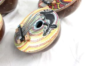 large size coconut shell finger karimba piano with handpainted thousand dots tribal designs Handmade in Bali, Indonesia.