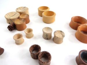 mixed wooden ear plugs, ear tunnels earlets, small to large gauge mix. Handmade in Bali Indonesia. Handcrafted gauges ear plugs, ear stretchers and expanders. Many designs, almost each pair is unique, assorted designs sizes gauges randomly picked by our staffs