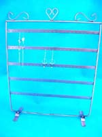 Copper colored 5 bar earring display rack with decorative design on top