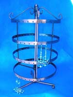 Copper colored earring jewelry rack in 4 tier circle design