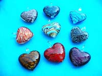 Abstract design inside heart shaped hand blown glass pendant