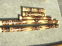 Handcrafted instrument rain stick with art designs