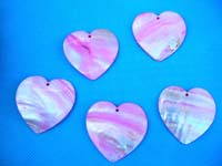 Light pink and white tropical colored pendant in heart shape, made from seashell