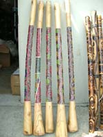 Musical wood didgeridoo with artist paintings