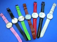 Fun theme clock face design on ladies watch, with colored imitation leather band