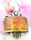 Imitation amber gemstone inlaid in fancy framed, sterling silver pendant