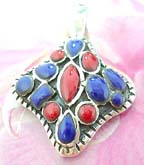 Red and blue stones inlaid in diamond shaped sterling silver pendant
