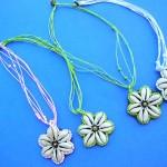 wholesale imitation amber necklaces. Starfish designed shell pendant on bali bali beaded necklace.