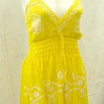 wholesale clothing Suppliers. Deep V rayon sundress with embroidery. Adjustable shoulder stripes. Elasticised smocked waist.