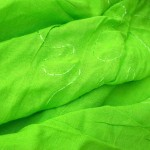fashion style. lime green plain sarong with embroidery.