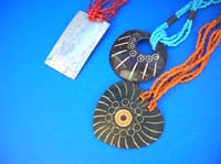 Wooden pendant necklace with engraved pattern
